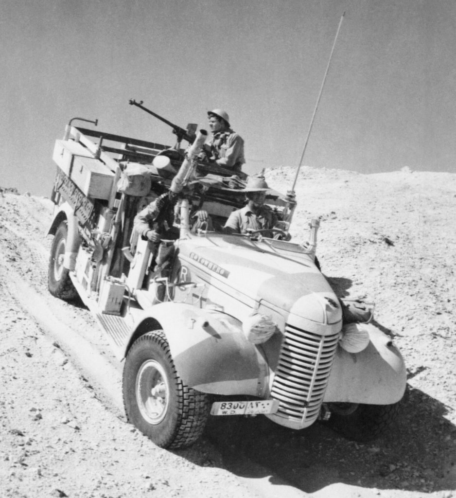 A_Long_Range_Desert_Group_Chevrolet_30cwt_1533_truck_negotiates_the_slope_of_a_sand_dune_during_a_patrol_in_the_desert,_27_March_1941._E2298