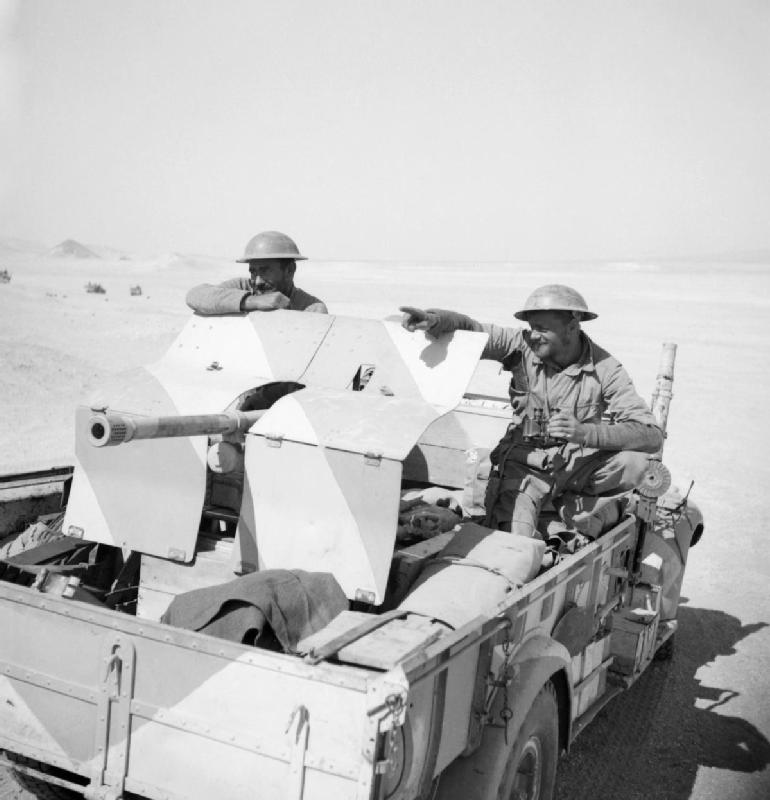 A_lorry_mounted_anti-tank_gun_in_the_Western_Desert_being_manned_by_New_Zealand_LRDG_troops_as_they_return_to_Cairo,_27_March_1941._E2301